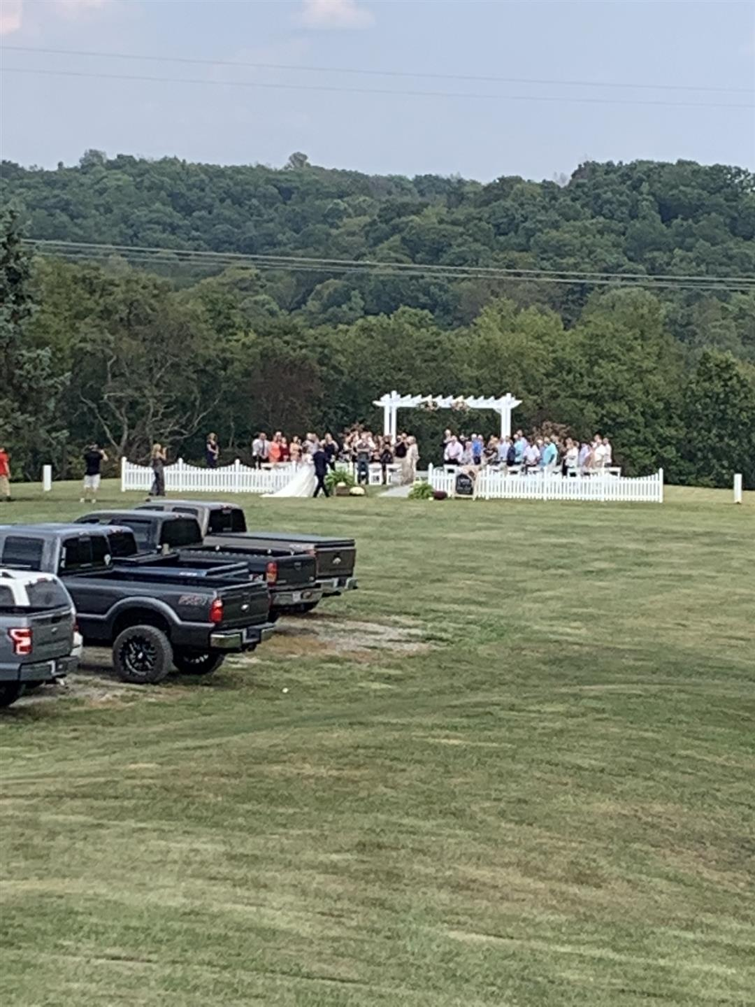 A far away view of a wedding reception.