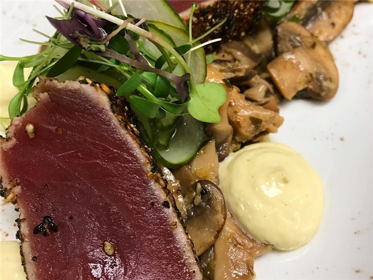Seared Yellow Fin Tuna Roasted muchrooms, ginger citrus soy vinaigrette and grilled yu-choi
