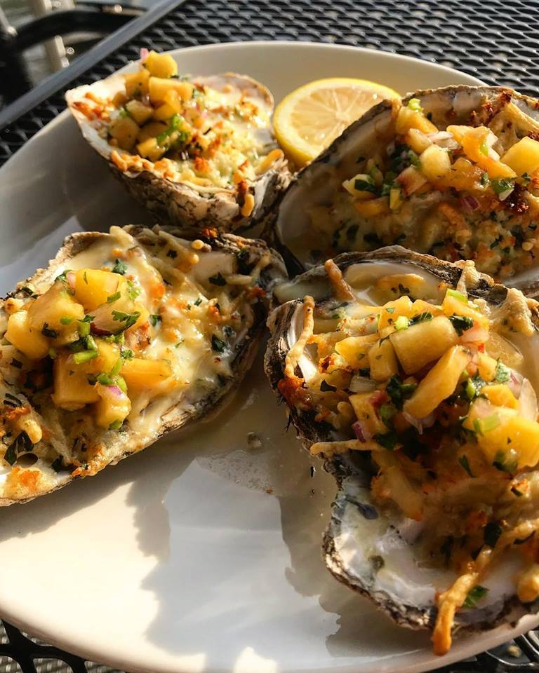 Baked Clams with corn and a side of lemon wedge
