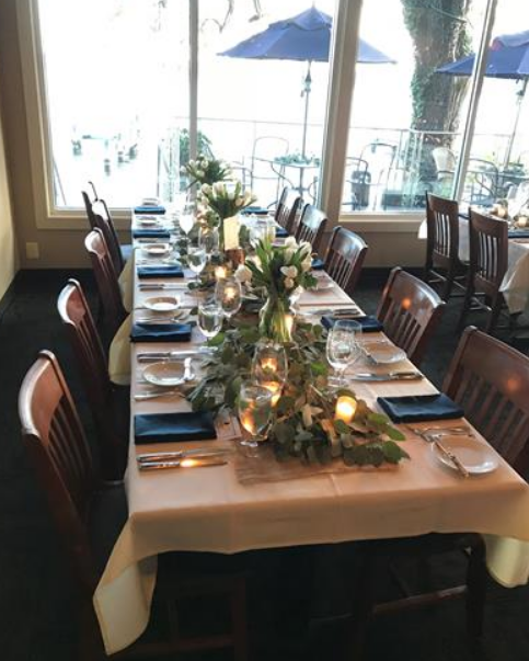 Festive table with chairs and blue place settings