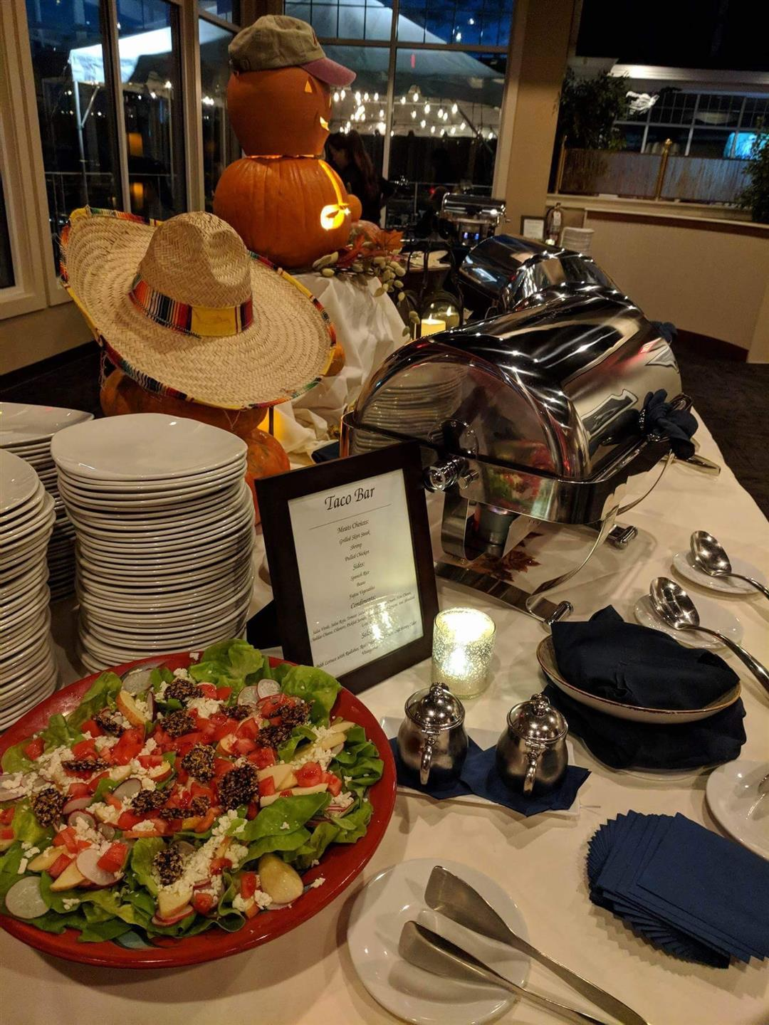 Decorated Buffet Table  with blue napkins, utensils, plates, and a salad