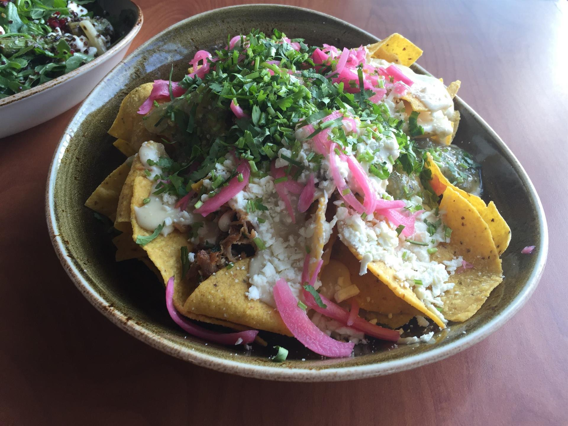 Nachos with cheese, pickled onions in a bowl