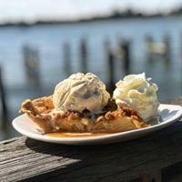 piece of pie with whipped cream sitting on the dock