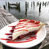 piece of pie on a plate sitting on the dock