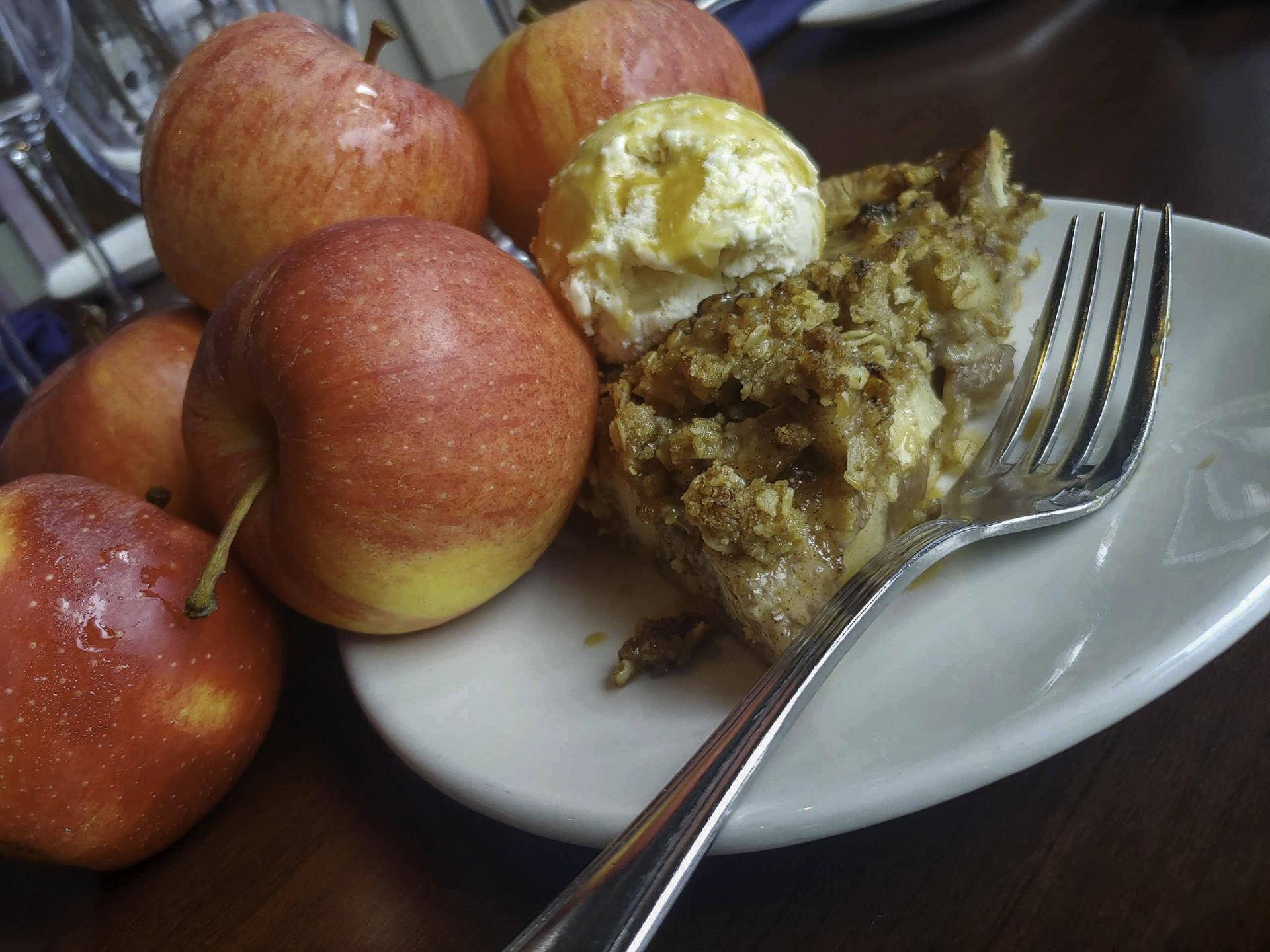 apples and pie with ice cream on top