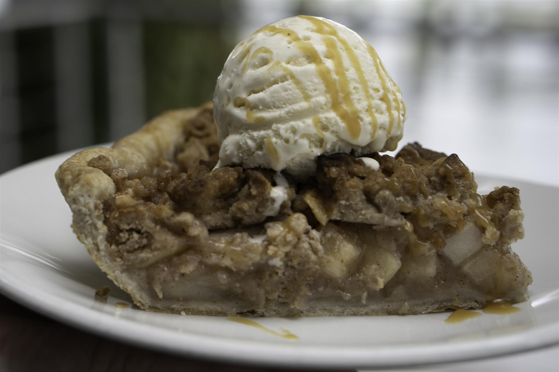 piece of pie with ice cream on top