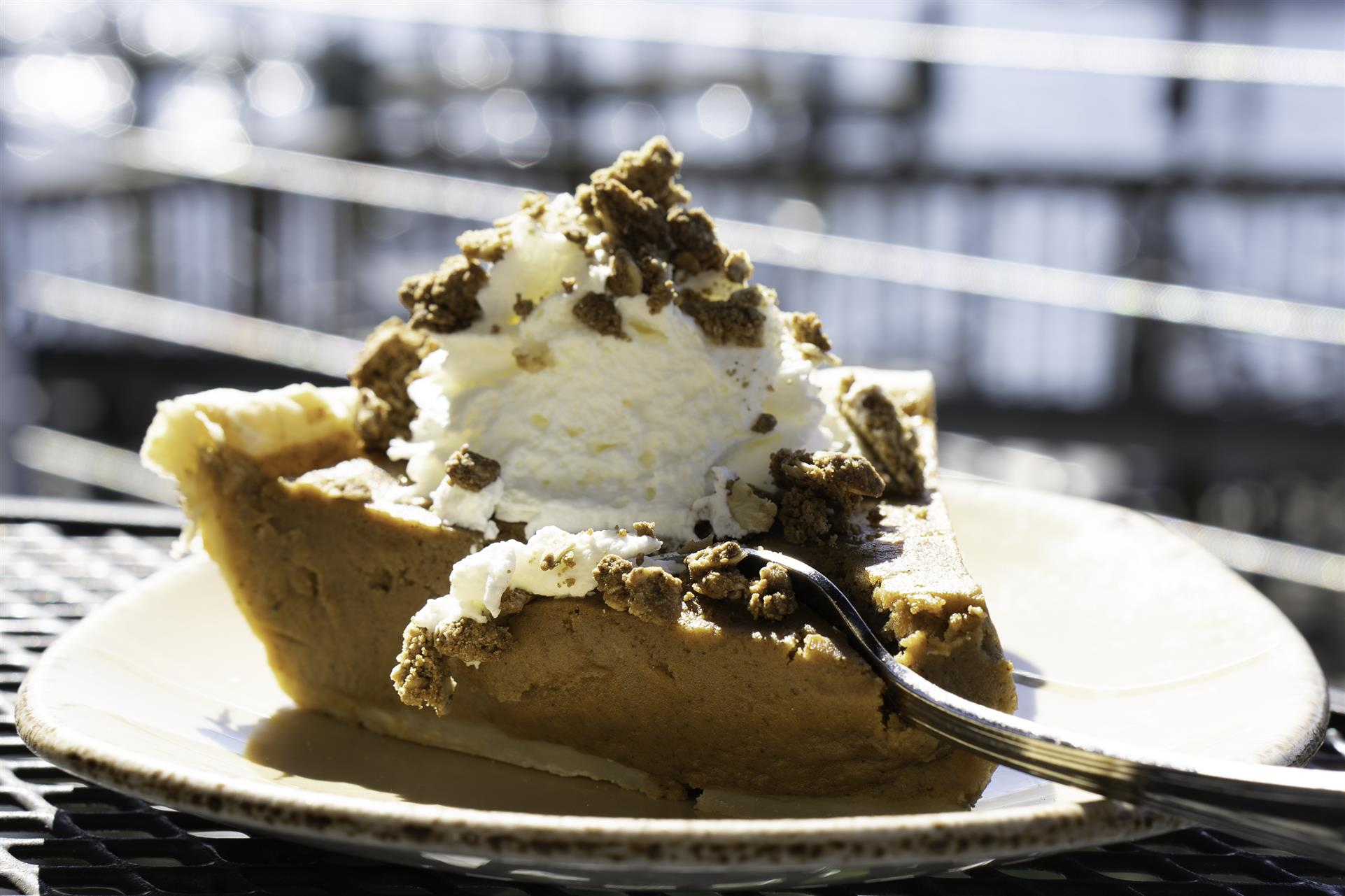 piece of pie with ice cream and chocolate on top