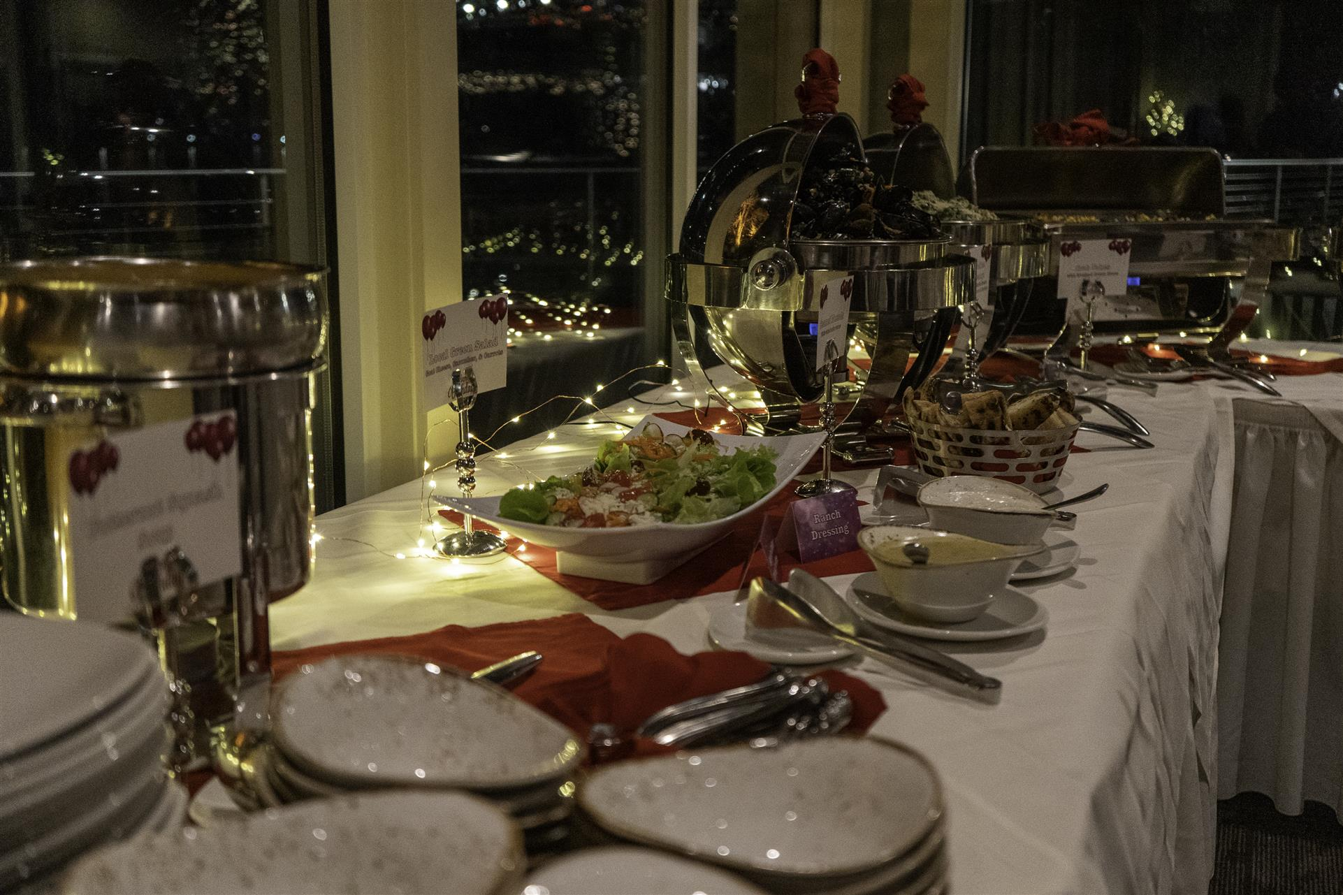 catering table with food trays