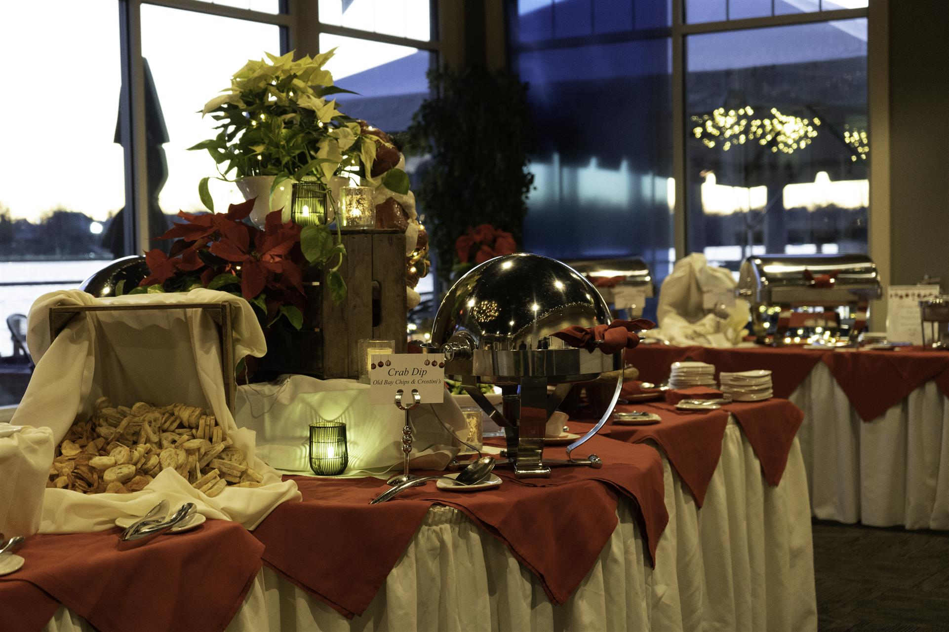 dessert spread with decorative flowers and candles