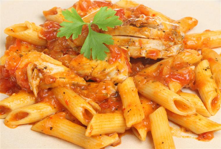 Penne pasta with chicken and red sauce.