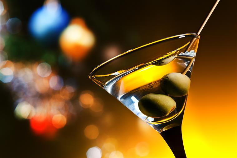 Closeup of martini with two olives.