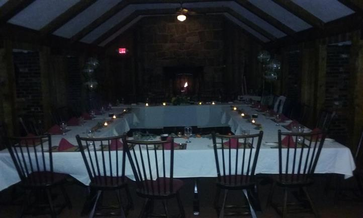 Tables set for dinner in a square shape and decarated with candles