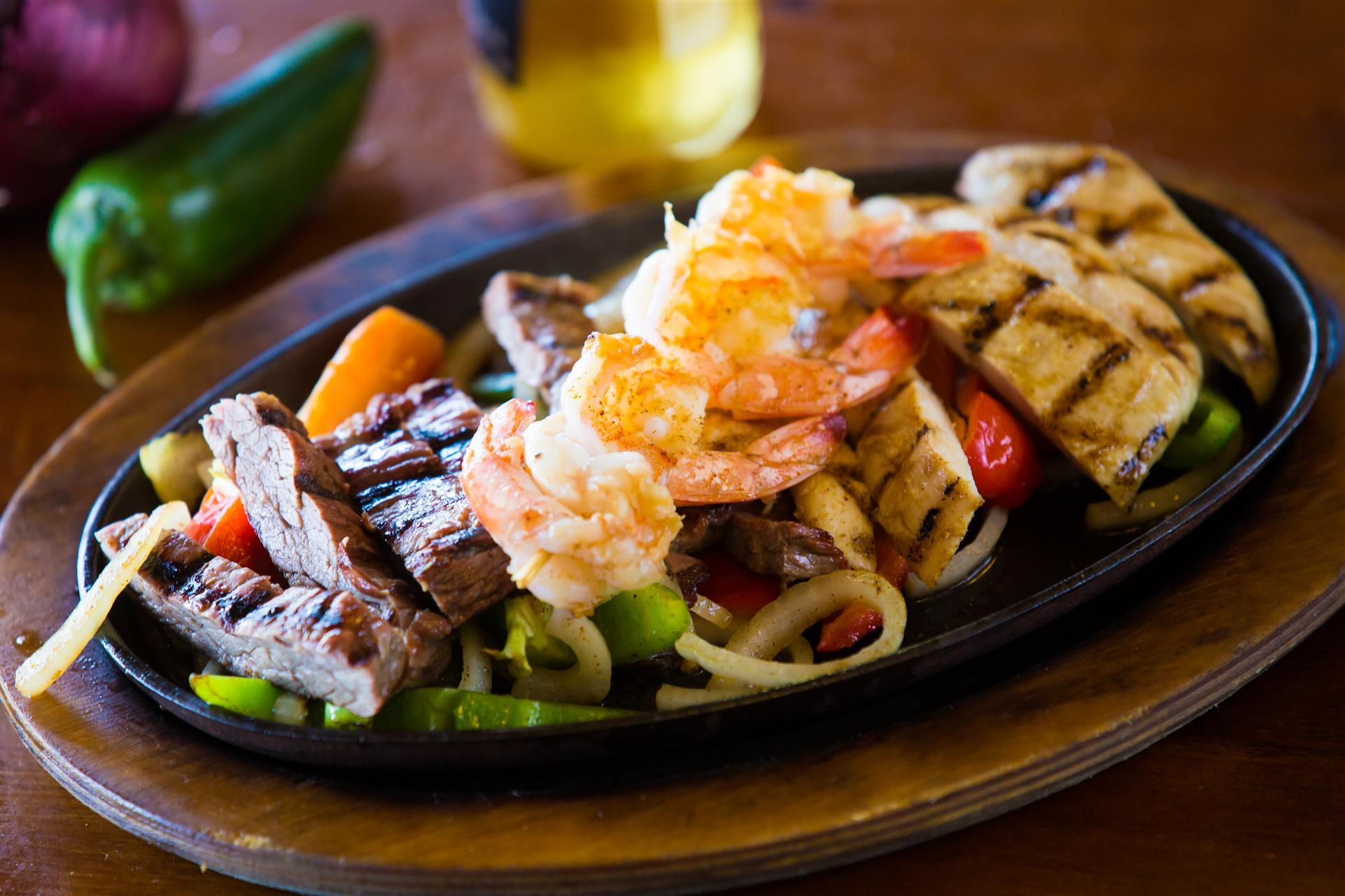 Steak and chicken fajitas over vegetables