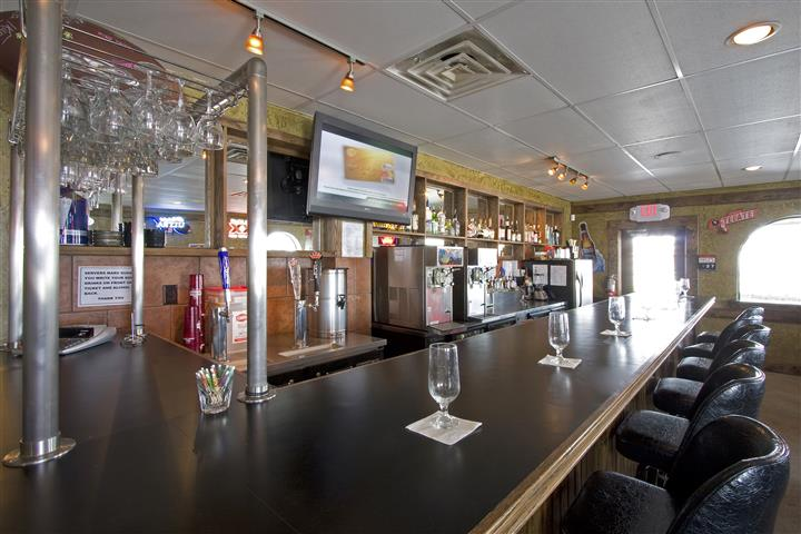 Bar counter with big screen tv in the background
