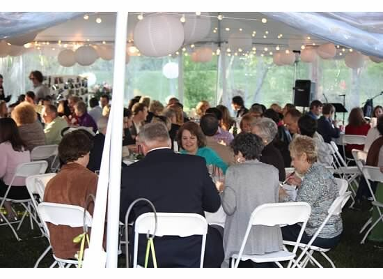 catering even twith a large crowd sitting down at tables under a large tent