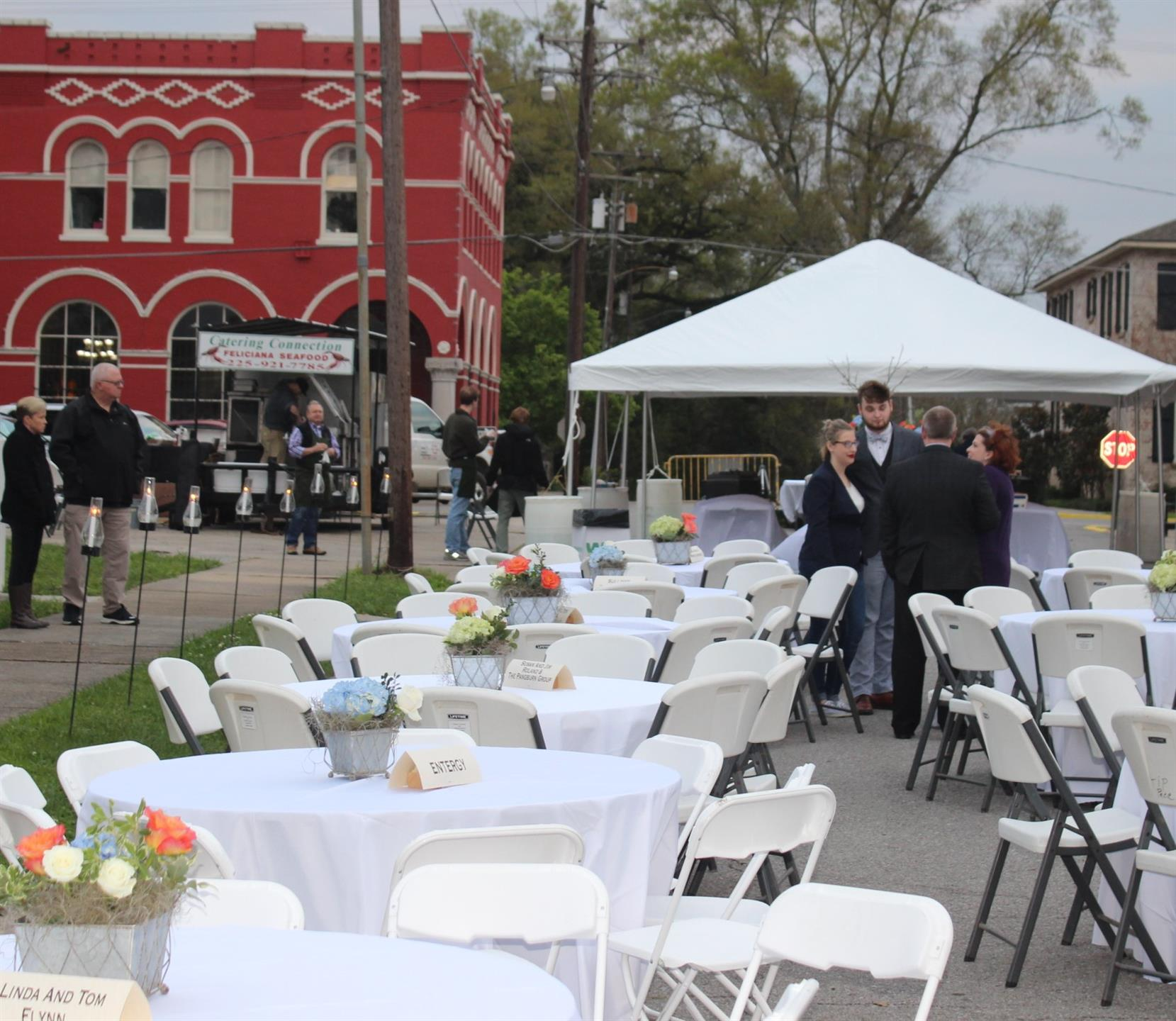catering event setup with tents, tables and chairs