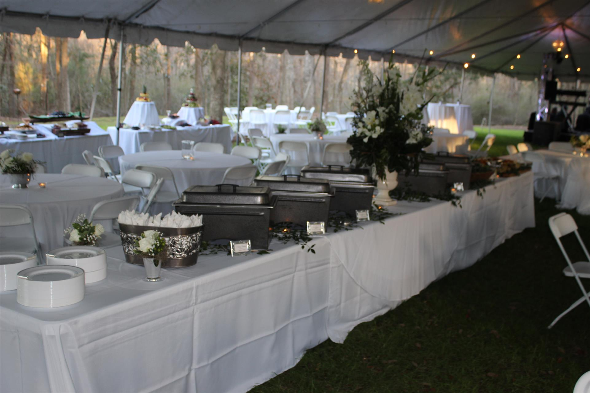 catering buffet station setup with metal trays and utensils