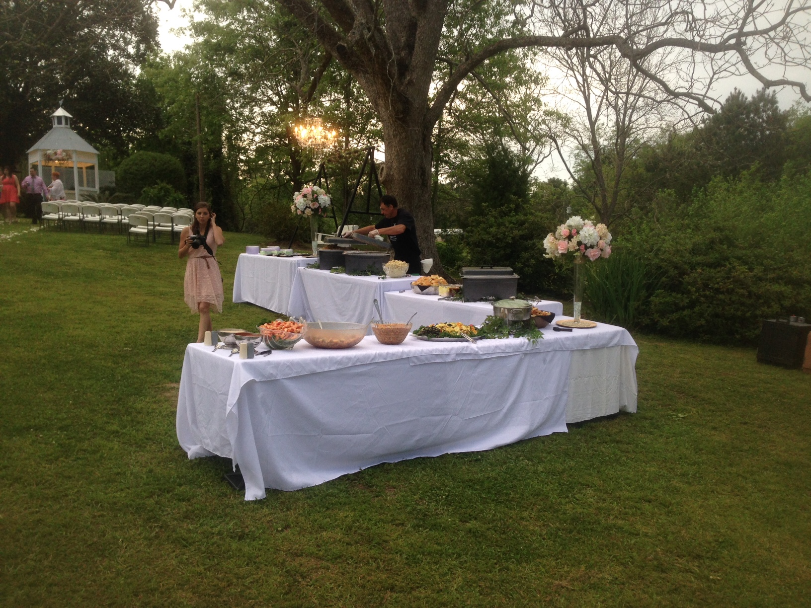 food set up buffet style on two long tables