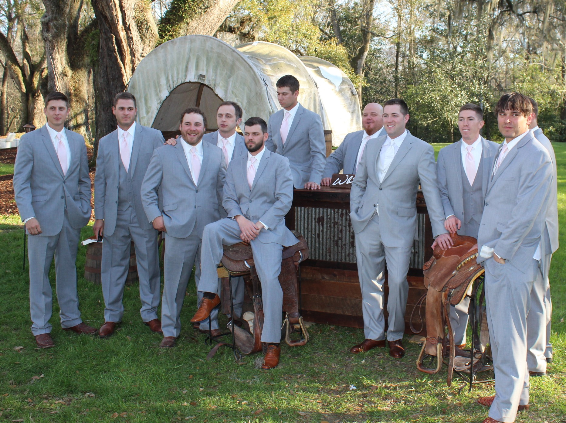 picture of 9 people in matching suits