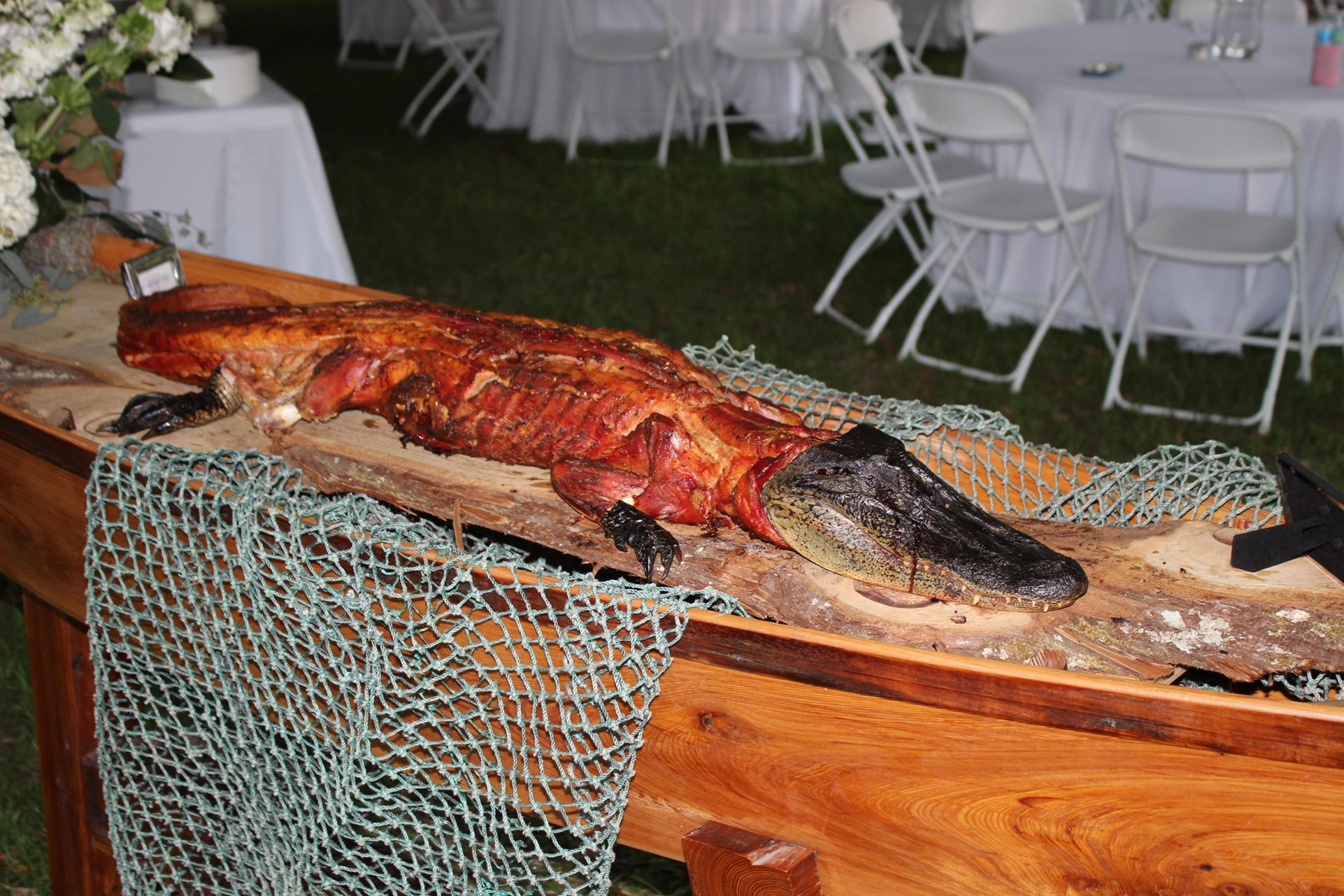 cooked alligator laying on a wooden table