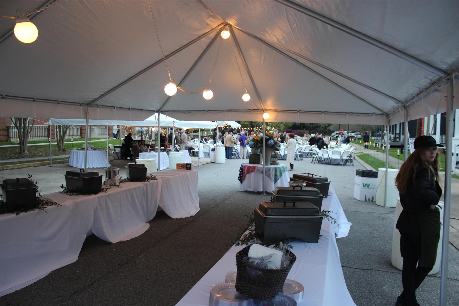tables set up for a buffet under a tent for an outside event