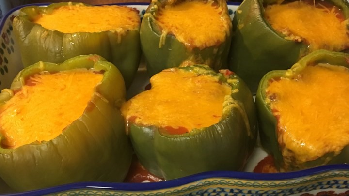 Stuffed peppers with melted cheese on top