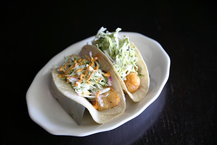 two shrimp tacos on dish