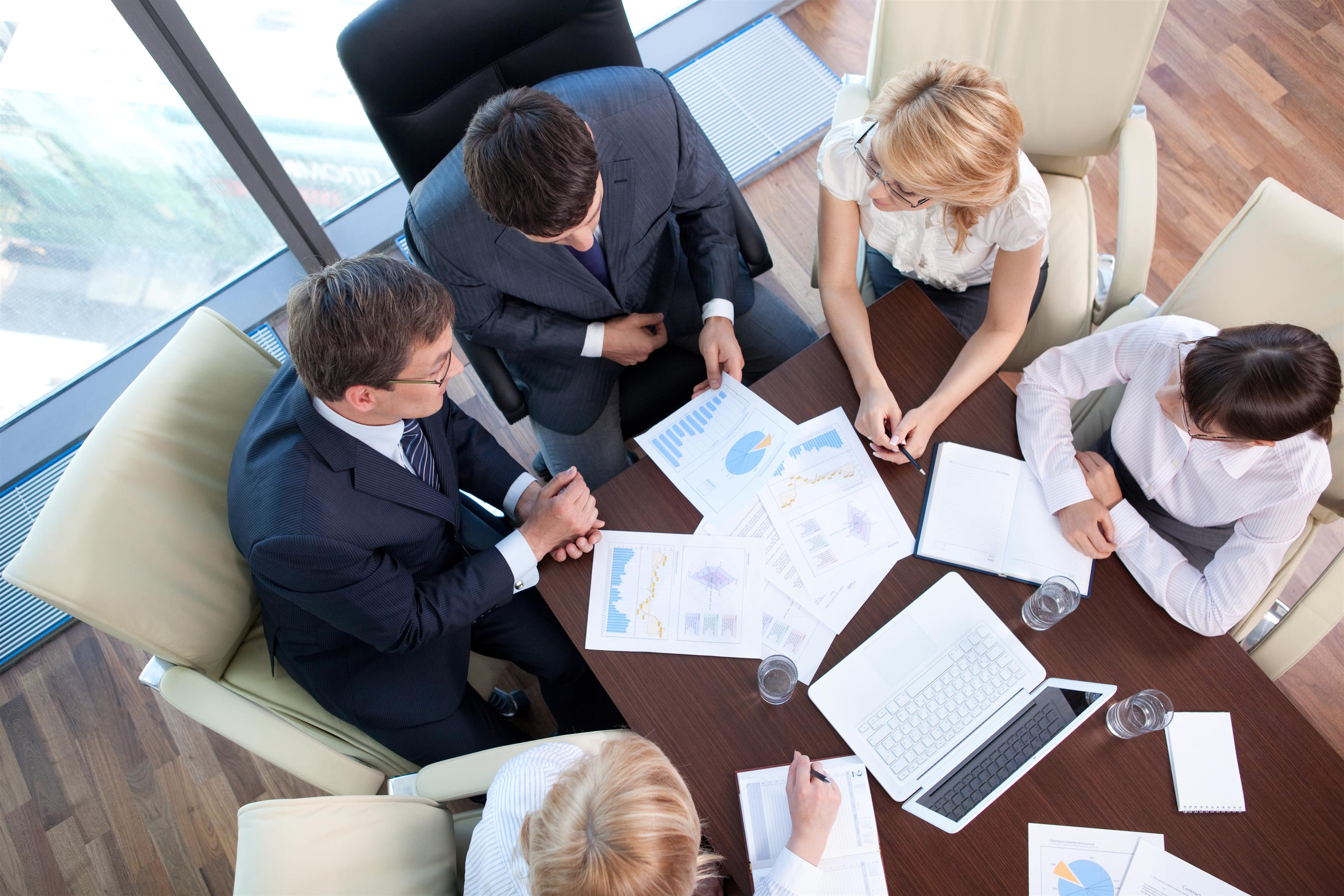 business people sitting at a table having a meeting