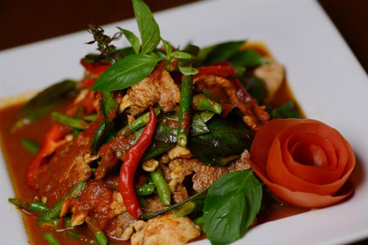 Pad Krapraw Chopped chicken, pork, or beef stir fried with fresh bell pepper, chopped garlic and basil leaves.