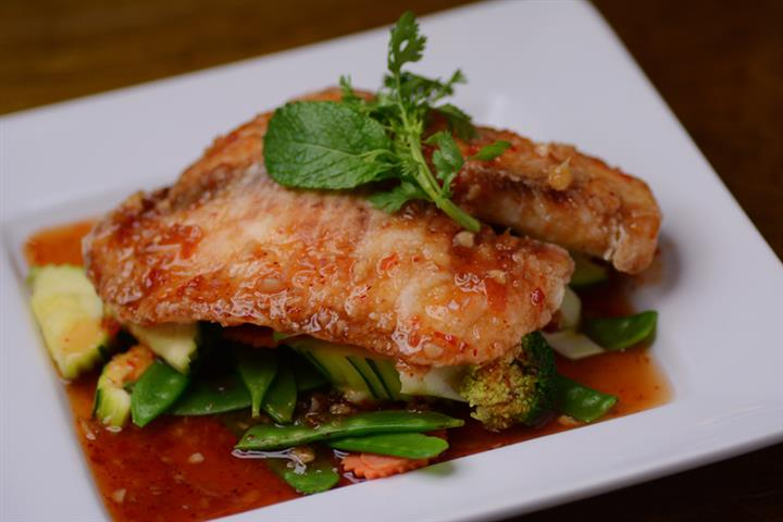 Half Roasted Duck. Thai BBQ sauce or Pineapple red curry sauce Served on mixed vegetables.