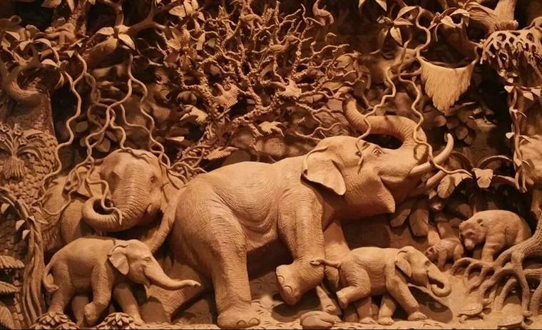 small elephants carved out of wood
