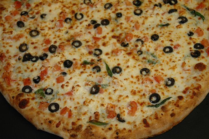 Pizza with olives and pepper slices