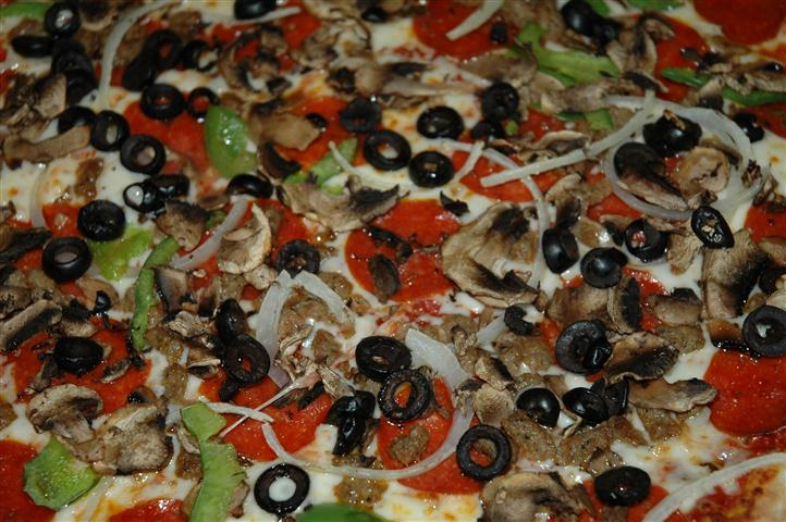Pizza with olives and sliced peppers