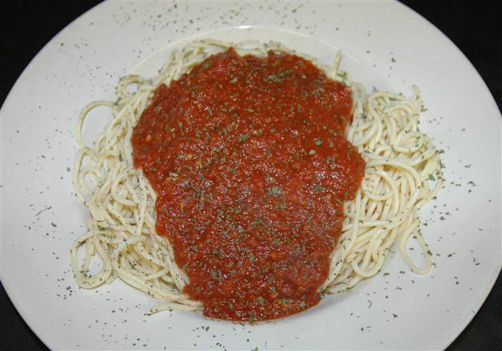 Spaghetti and meatsauce with basil sprinkles