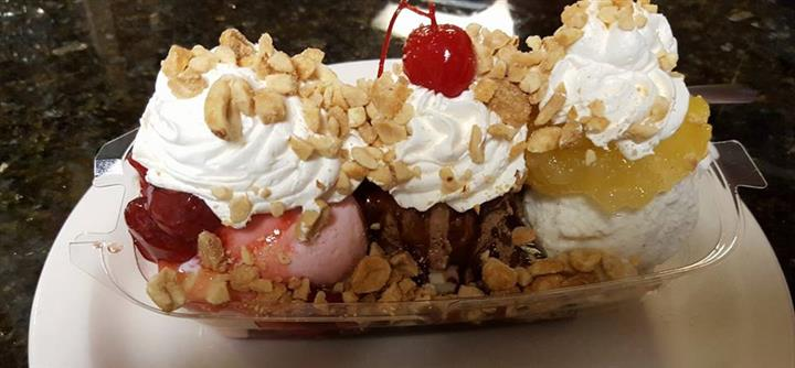 Ice cream sundae with whipped cream and crumbles
