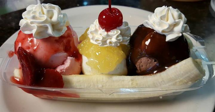 Ice cream sundae with whipped cream and strawberries