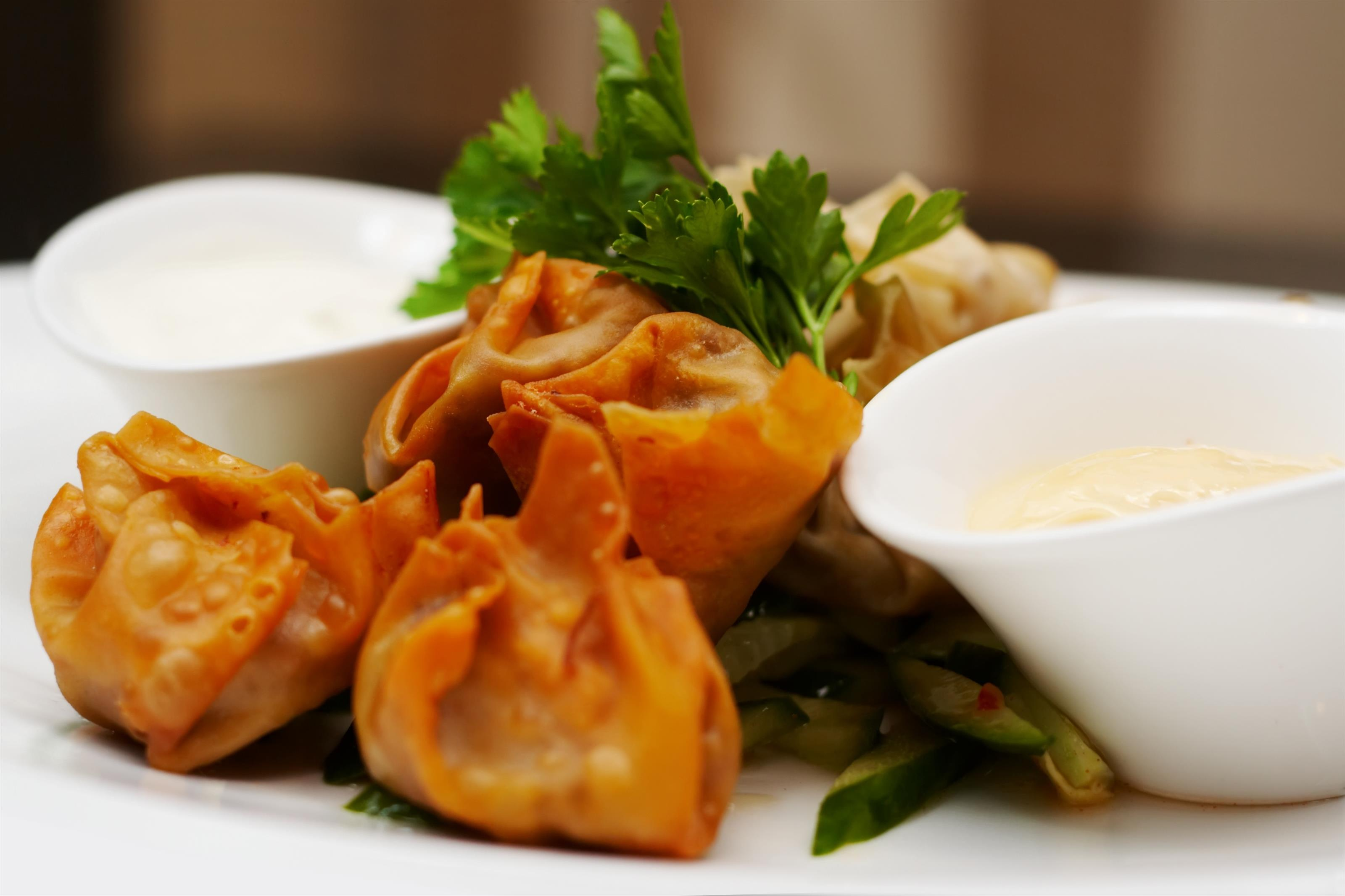 Crab Rangoon: Crispy fried wonton filled with cream cheese and real crab meat.
