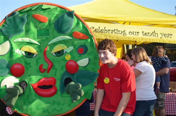 Sexy salad mascot next to a boy