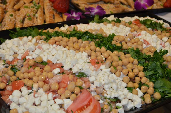 Vegetable and cheeses on a big platter