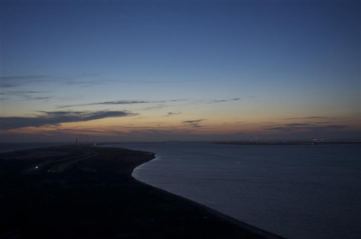 Photo of sun setting from an aerial view