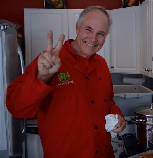 Chef making a peace sign while smiling