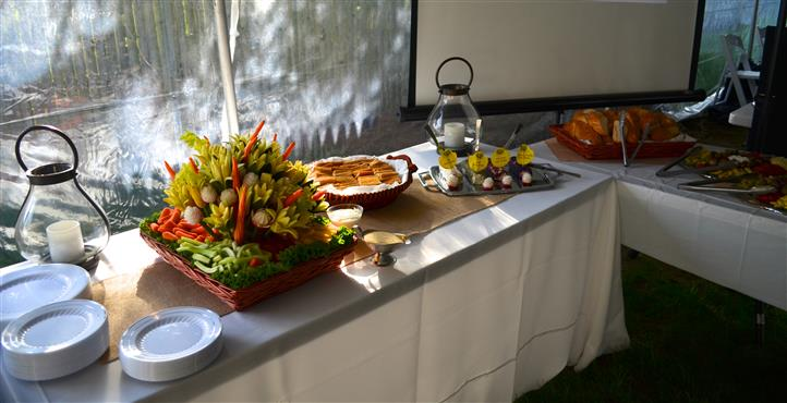 Catering table with an arrangement of different foods and horderves