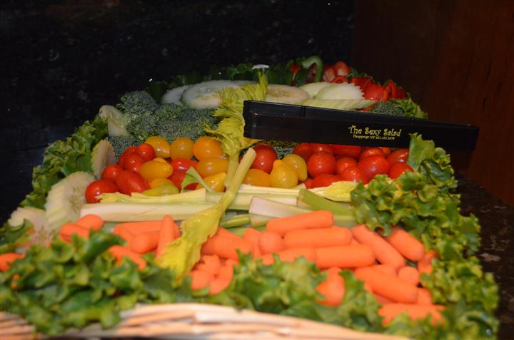 Vegetable arragement with tongs