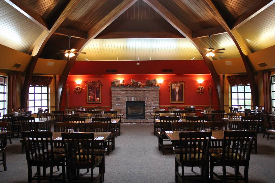 DIning hall showing tables, chairs, high arched ceilings