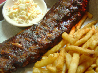 Rack of ribs with fries and cole slaw