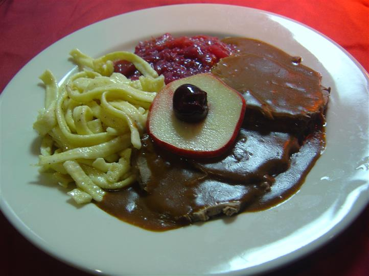 Noodles, meat and gravy on plate