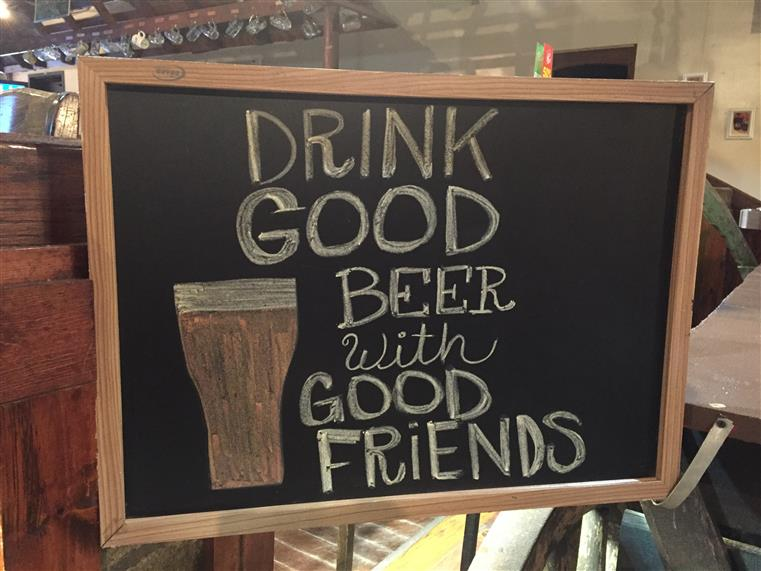 Chalkboard sign reading Drink good beer with good friends