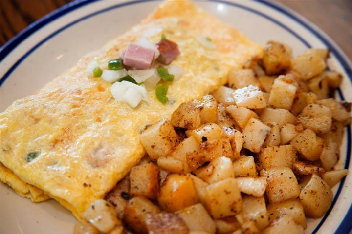 Omelette folded and served with homefries