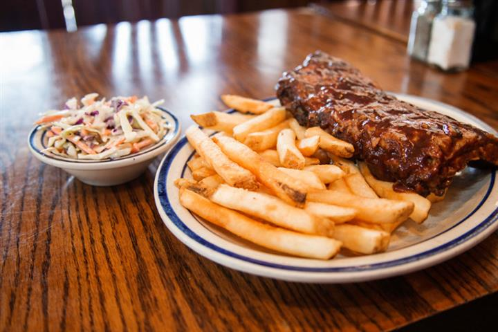 Rack of ribs served with fries and a side of coleslaw