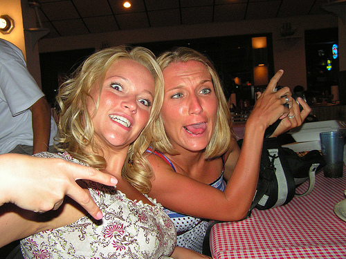 two females making funny faces